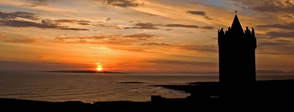 Sunset over Doolin. Donogore castle and the Aran Islands
